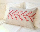 Natural linen pillow cover with geometric design in red inspired by tribal pattern