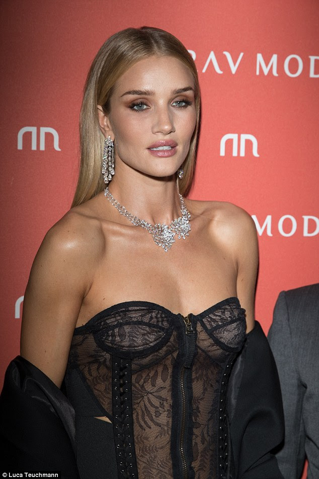 Sheer delight: The Mad Max: Fury Road star showed off her svelte physique to perfection in the slinky bustier, which featured racy lace-up detail and a zip