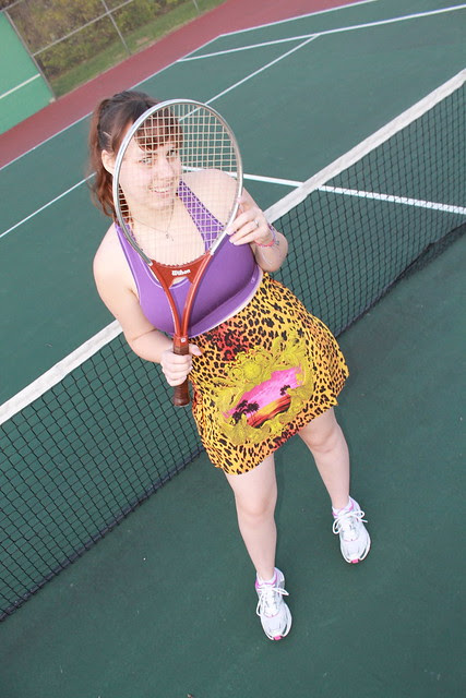 Tennis outfit: Versace for H&M silk pleated skirt, Brooks running shoes, Champion sports bra, vintage Wilson tennis racket