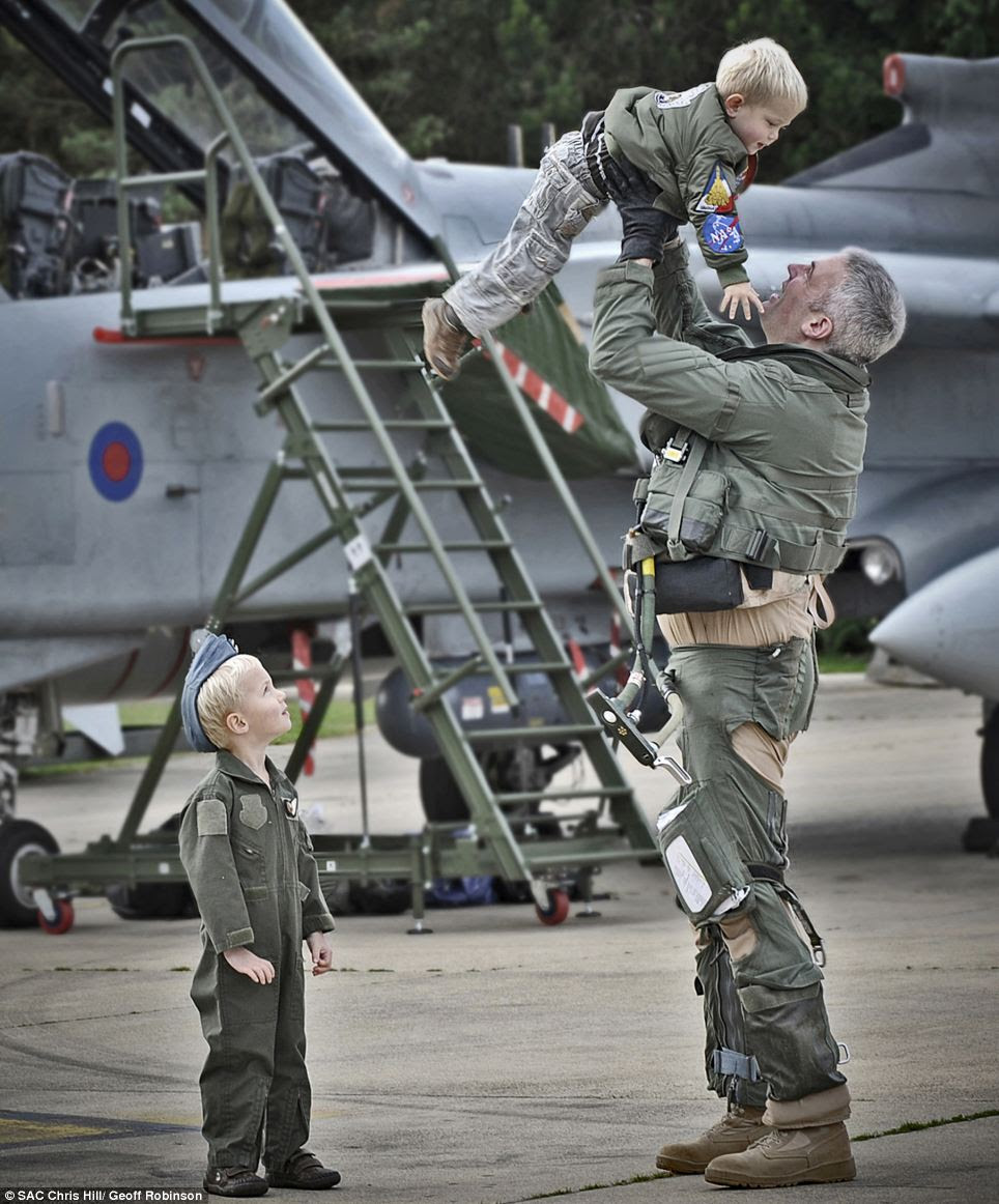 Welcome Home by SAC Chris Hill shows this delighted serviceman greeting his two children after returning to RAF Marham from operation Ellamy
