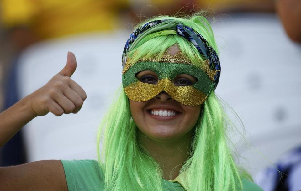 A fan dressed in colorful ensemble to show her World Cup spirit before the opening ceremony at the Corinthians arena in Sao Paulo on June 12.