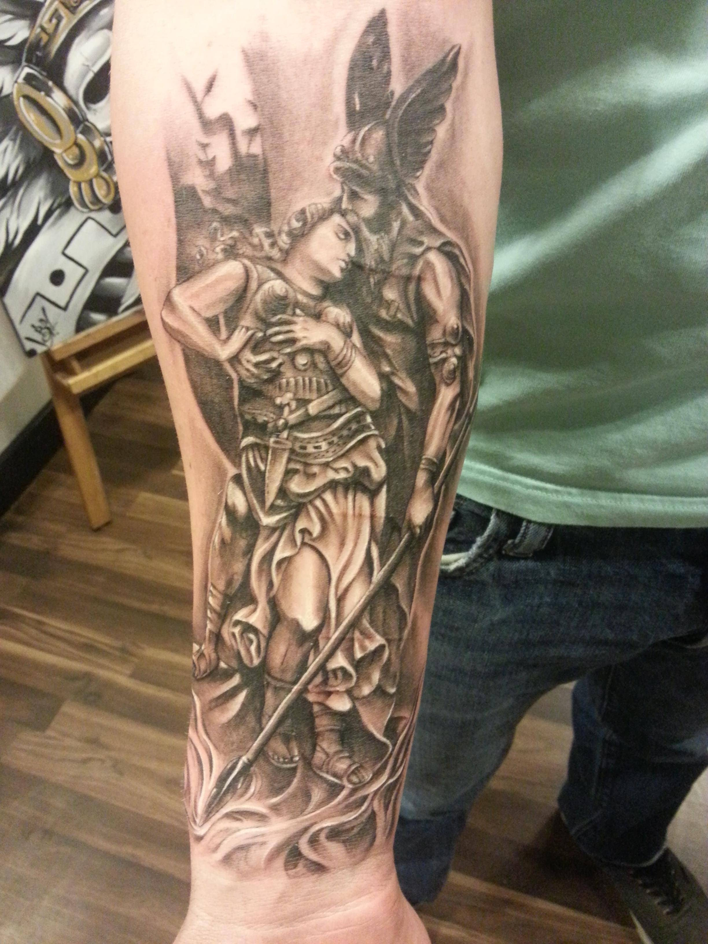 Old Greek Tattoo On Sleeve