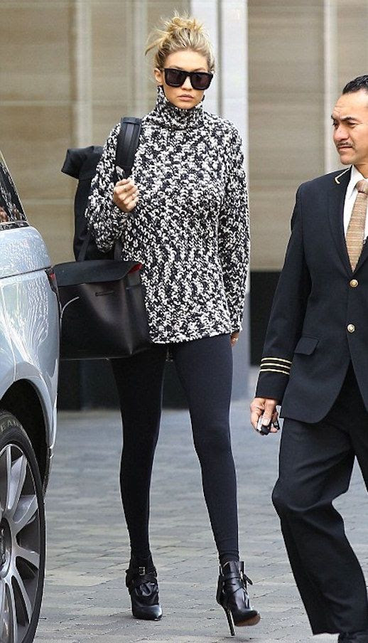 Le Fashion Blog Model Gigi Hadid Style Black And White Turtleneck Sweater Mason Gabriel Lady Bag Leggings Buckle Pointed Ankle Boots Via Daily Mail UK