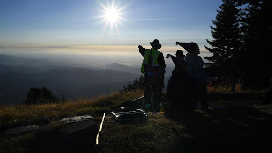 Eclipse-watchers party on the peak