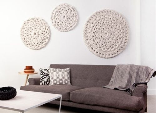 Here's another brilliant crochet in the home idea! Motifs used as wall hangings! Lovely.