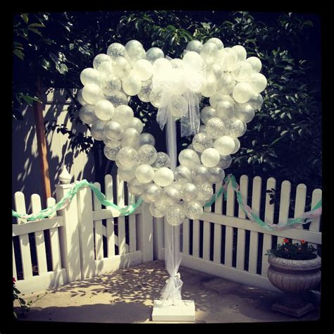 Heart shaped sculpture   set on stand for an outdoor
