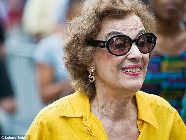 Sunny yellow: The women, who love bright colors, pink lipstick oversize sunglasses and a dollop of make-up, are usually pictured scowling or expressionless