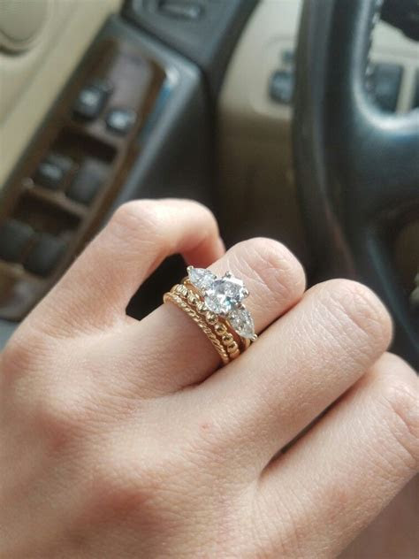 My yellow gold stacked wedding bands & 3 stone oval and