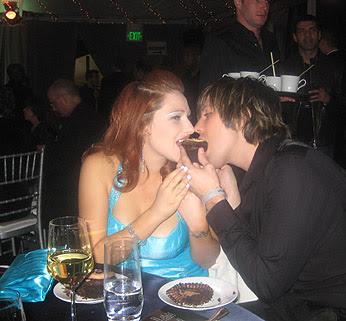 Tiffany eats a cupcake at Oscar party