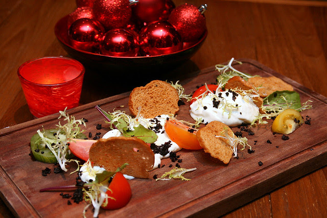 Goats cheese mousse with heirloom tomato, olive, brioche, wild honey