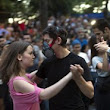 Turks tango in their gas masks as they defy orders of Prime Minister and carry on with protests