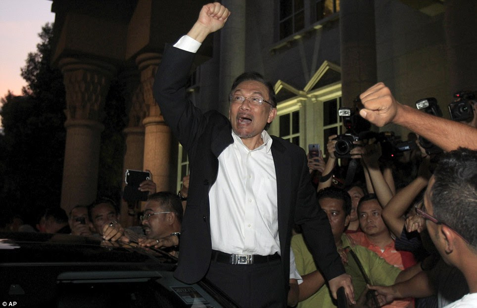 Jailed: Malaysian opposition leader Anwar Ibrahim leaving court in Putrajaya on March 7