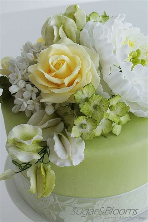 Sugar flower cake in soft green and yellow shades