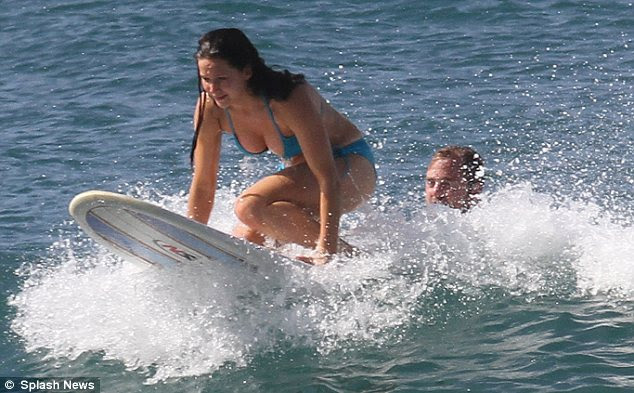 Riding high: Jennifer was seen showing no fear as she sat perched on the front of the board