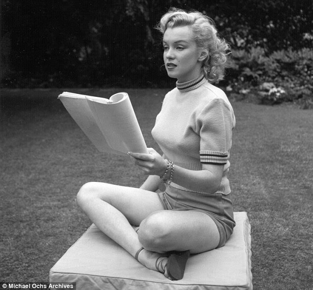 Learning her lines: Marilyn studies her script in between takes