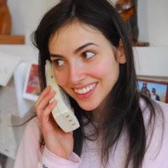 Woman_using_cordless_telephone