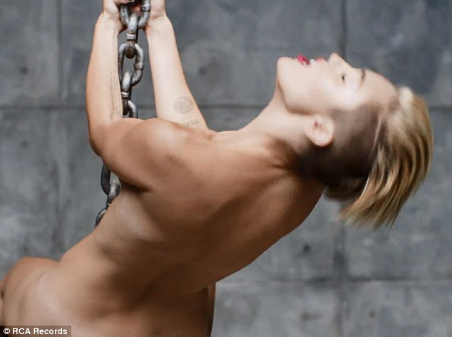 Looking for hits: Miley bares all in the new video and is hoping it will smash Vevo records for views
