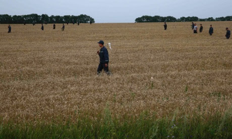 The search for bodies near the site of Thursday's Malaysia Airlines plane crash near Grabovo, in the Donetsk region of Ukraine.