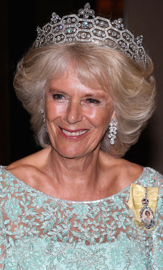 The Duchess of Cornwall wearing the pendant in 2013. Look back at the real history behind all of Kate's royal jewelry.