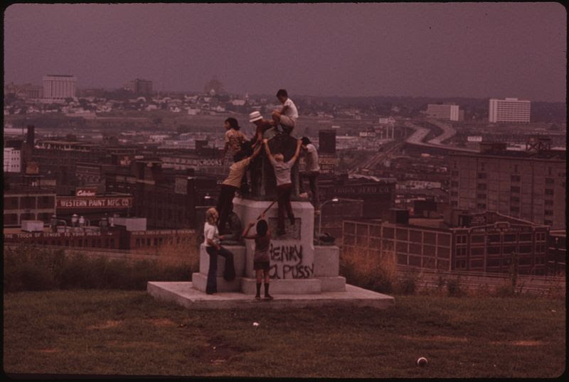 "File:LOOKING OVER ""WEST BOTTOMS"" OF KANSAS CITY FROM MULKY SQUARE PARK, A CITY FACILITY. PARK MONUMENT MAKES GOOD CLIMBING - NARA - 553513.jpg"