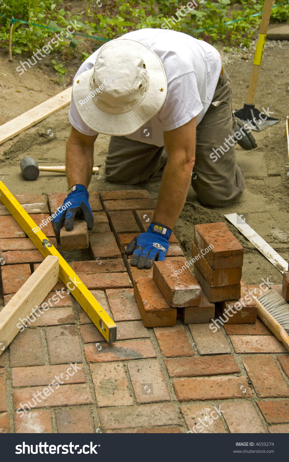 Man Laying A Brick Patio Stock Photo 4659274 : Shutterstock