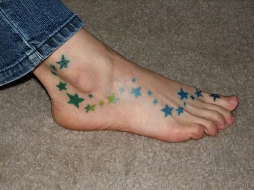 small star tattoo on foot