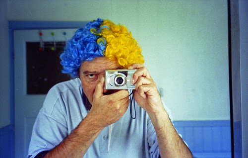reflected self-portrait with Olympus mju V camera and blue and yellow hair by pho-Tony