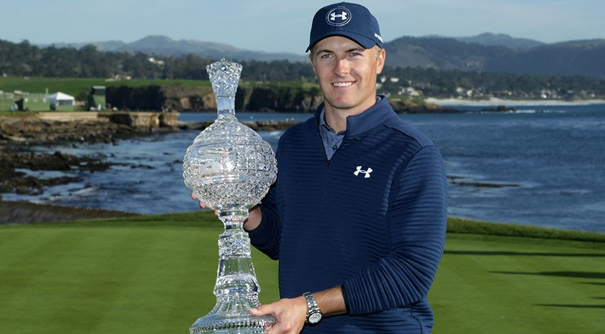 Jordan Spieth with the AT&T Pebble Beach trophy