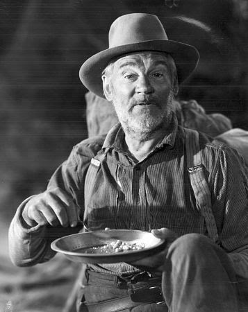 Walter Huston as Howard