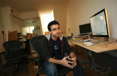 Sahil Lavingia, 19, Chief Executive Officer (CEO) of Gumroad, an online payments company he started, sits in front of computers at his home which doubles as his office in the SOMA neighborhood of San Francisco February 17, 2012. Lavingia, who was born in New York and grew up in places like London, Hong Kong and Singapore, dropped out of the University of Southern California to work at online bulletin board company Pinterest. He also developed the Turntable.fm app for the iPhone.  REUTERS-Robert Galbraith