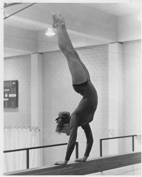 Gymnastics Student Performing Handstand on Balancing Bar