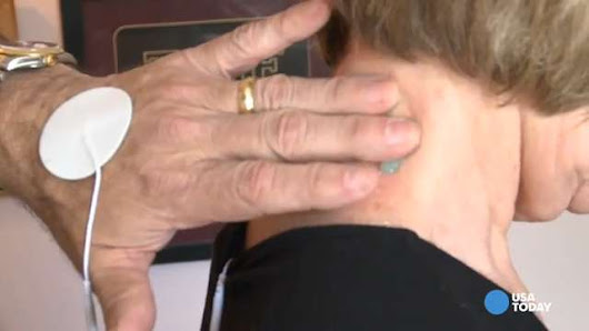 Chiropractor demonstrates how spinal manipulation can ease pain