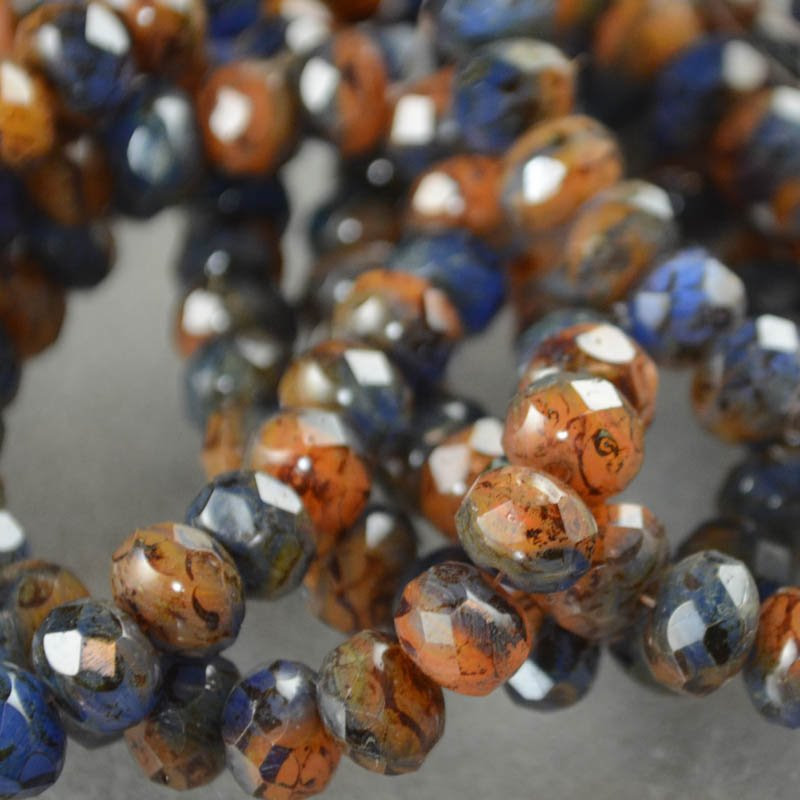 s38635 Firepolish - 9 x 6 mm Faceted Donut - Slate and Iron (strand 25)