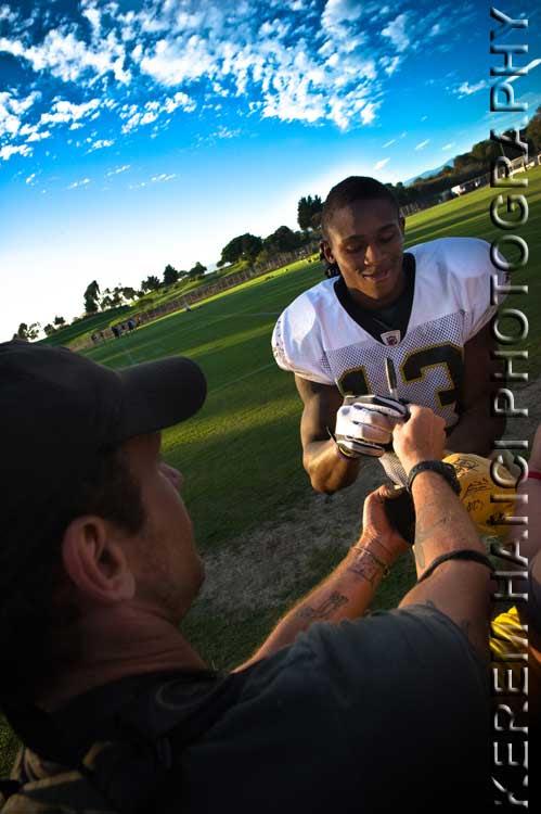 New Orleans Saints' wide receiver Jason Morgan signing Vivienne's hat