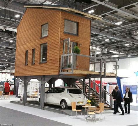 architect designs tiny flats  stand  stilts  car