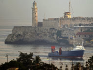 """US cargo ship """"Ana Cecilia"""" arrives at the Havana Bay, Cuba, early Friday, July 13, 2012. The """"Ana Cecilia"""" is the first ship for half a century to carry humanitarian supplies from Miami to Havana. The shipping company, International Port Corporation, said its clients include charitable, religious, and humanitarian groups, as well as family members of people in Cuba. (AP Photo/Franklin Reyes)"""