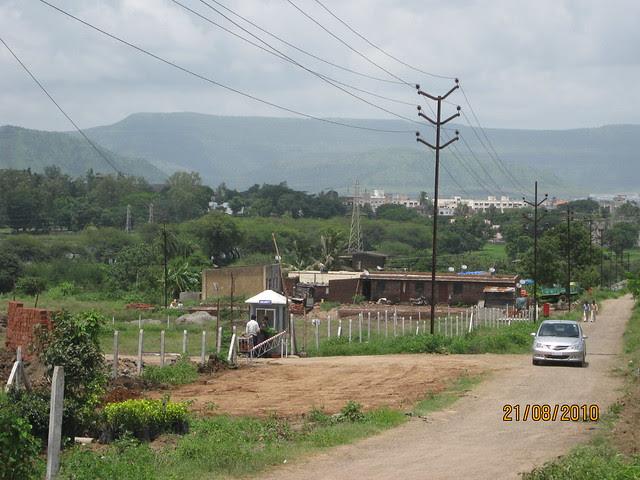 60' DP Road and main entrance of Naiknavare Lakeshore Residency, at Talegaon, on Old Mumbai Pune Highway (NH4)