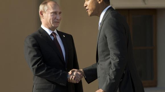 Wladimir Putin begrüßt Barack Obama