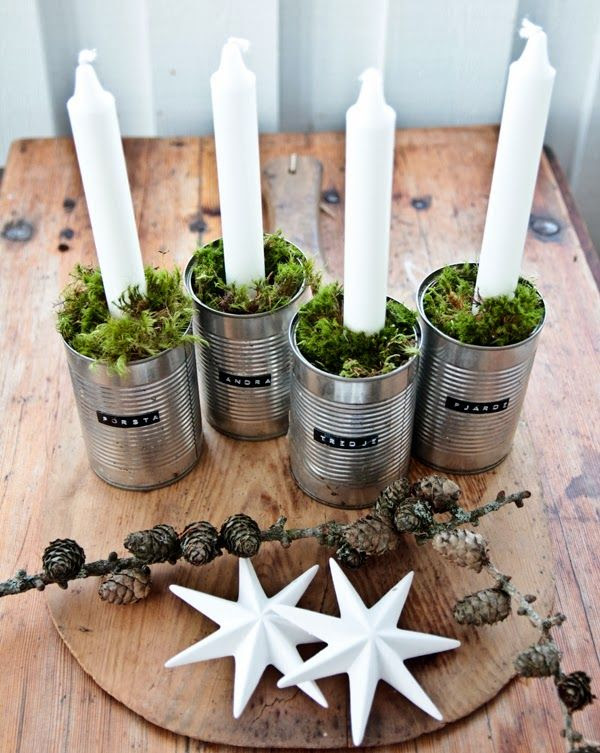 Advent wreath with tin cans, candles, and greenery.