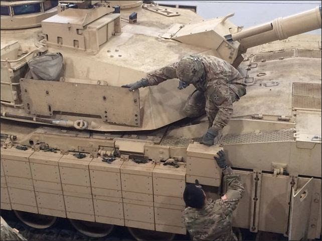 U.S. tank and maintenance crews from 1st Battalion, 66th Armor Regiment, have upgraded M1A2 Abrams Sep V2 main battle tanks with new Abrams Reactive Armour Tile (ARAT) that improves the overall defensive capabilities of the tank.