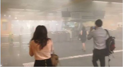 Commuters exit as thick smoke engulfs the Newton MRT station