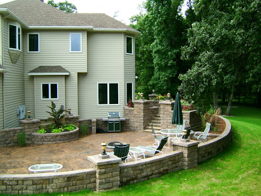 Stained Concrete Patio with Retaining Walls and Lots of Landscape Lighting | Oasis Landscapes | Fargo, ND | West Fargo, ND | Moorhead, MN