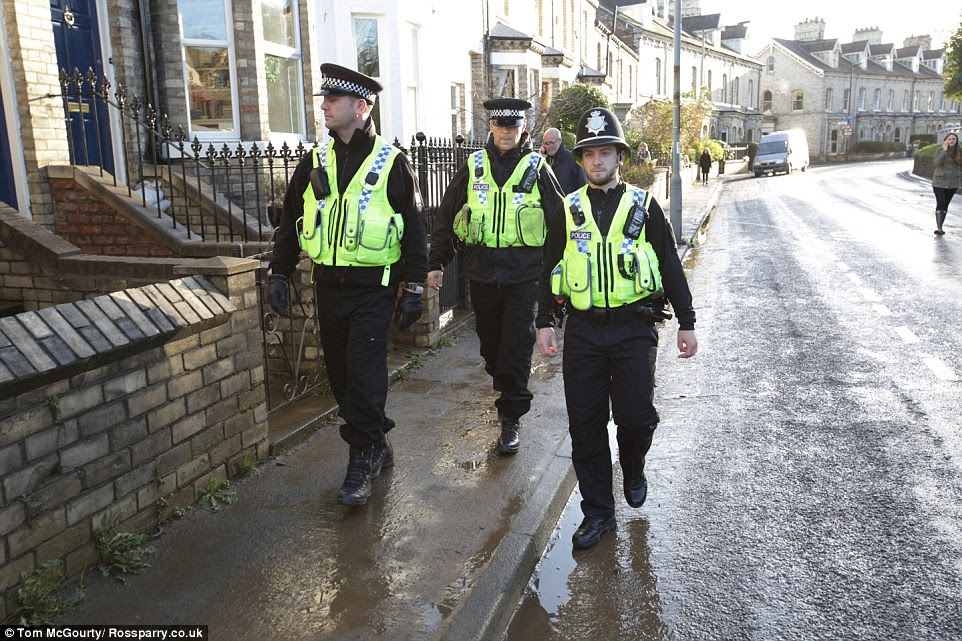 On the beat: North Yorkshire Police officers patrol the streets today after cases of looting in York in the aftermath of the floods