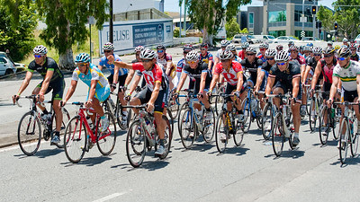The front of the group, led by Robbie McEwen, Allan Davis & Lance Armstrong, approaches the finish - Queensland Ride Relief, led by Lance Armstrong, Robbie McEwen & Allan Davis; Brisbane, Queensland, Australia; Monday 24 January 2011. Photos by Des Thureson - http://disci.smugmug.com