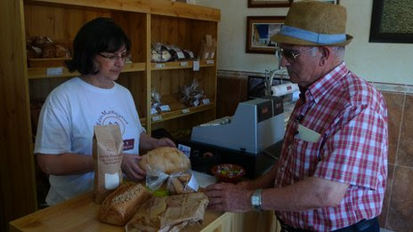 A man buying baked goods in the company shop