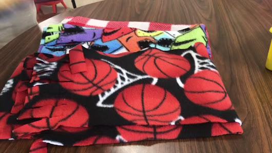 Teacher honored for creating scarves to help students stay warm