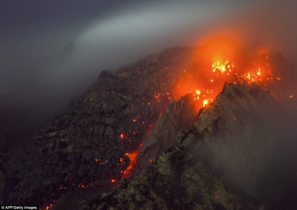 'Ring of Fire': Mount Sinabung (pictured) is one of 130 volcanoes on Indonesia's infamous 'Ring of Fire' which are prone to violent and unpredictable eruptions because of their location between tectonic plates