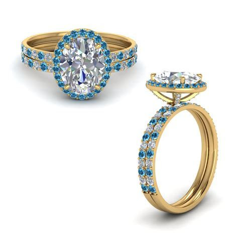 Prong Studded Oval Halo Diamond Bridal Set With Blue Topaz