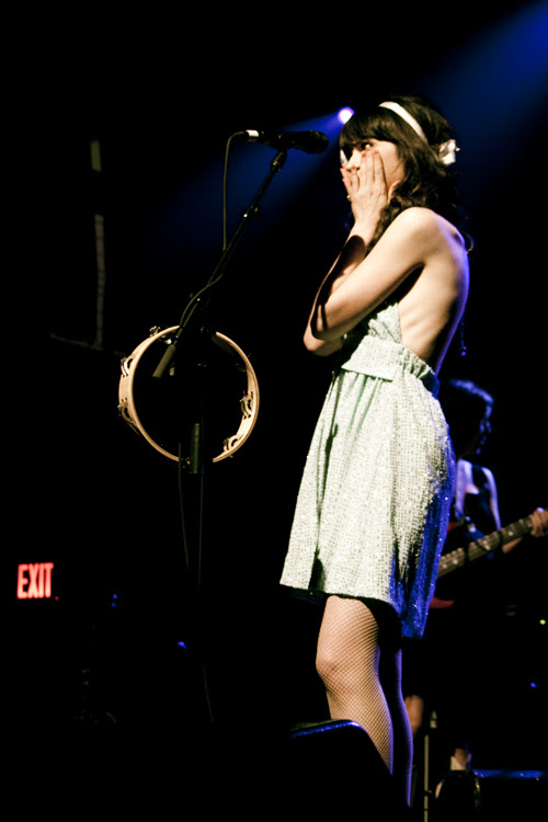 Zooey Deschanel with fishnets at a concert