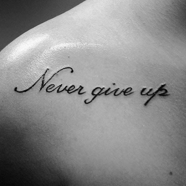 60 Never Give Up Tattoos For Men Phrase Design Ideas